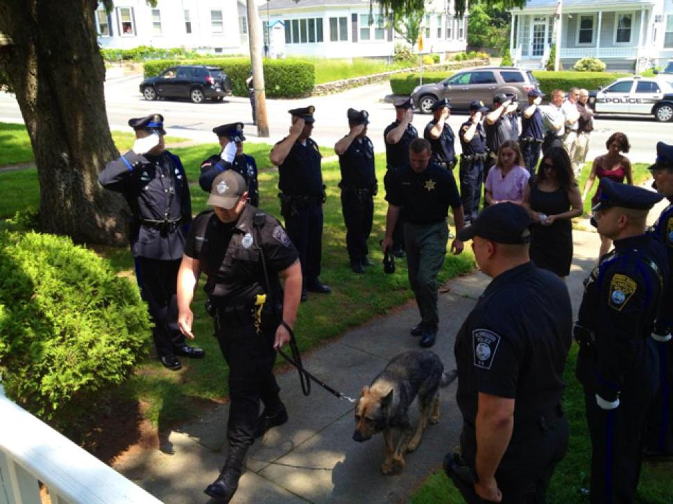 3. Officers gave Kaiser a final salute he made his way to the vet for the last Plymouth Police Working Dog Foun