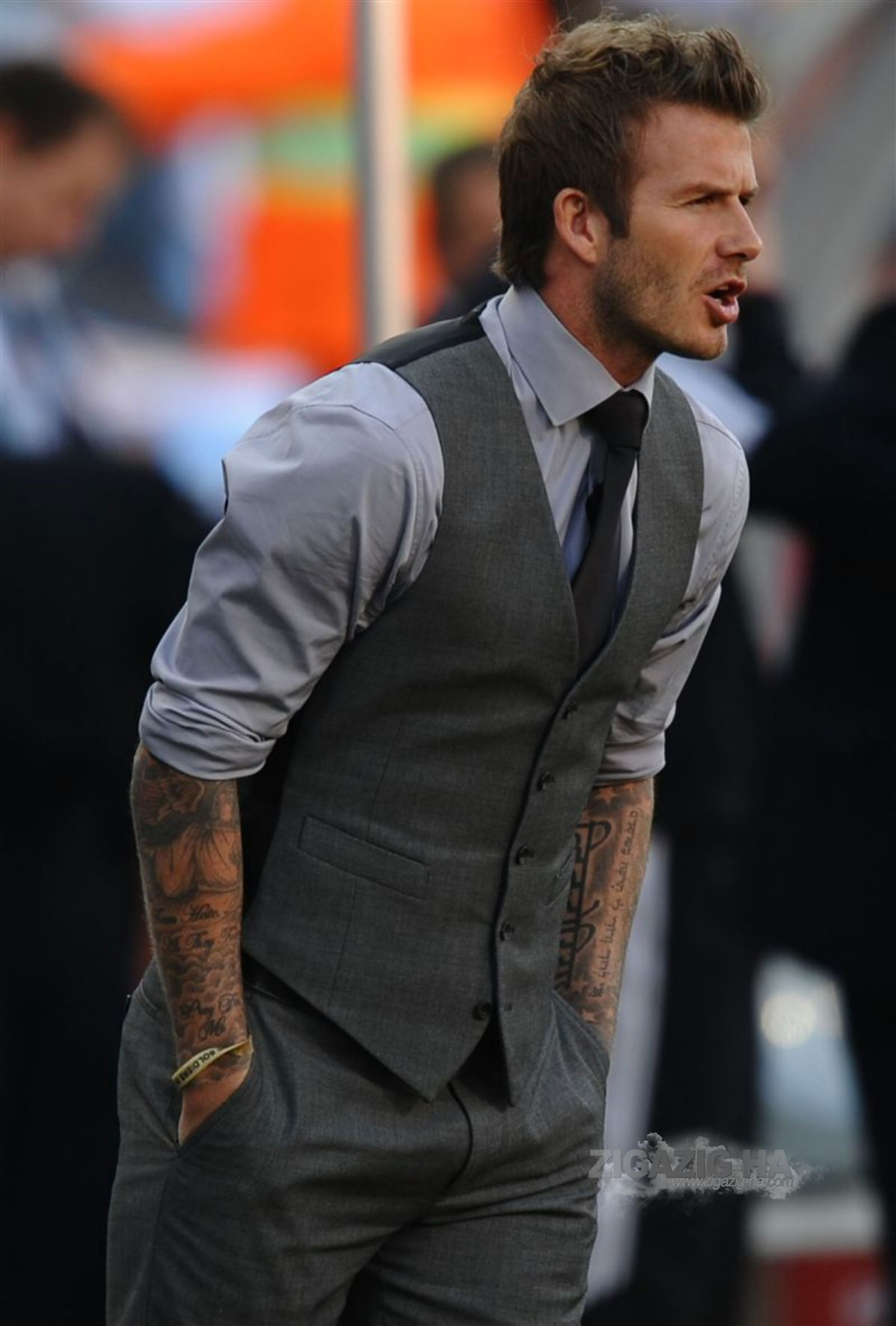 Opt for a charcoal or gray suit over black